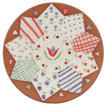 A photo of a handmade ceramic floral patchwork design platter