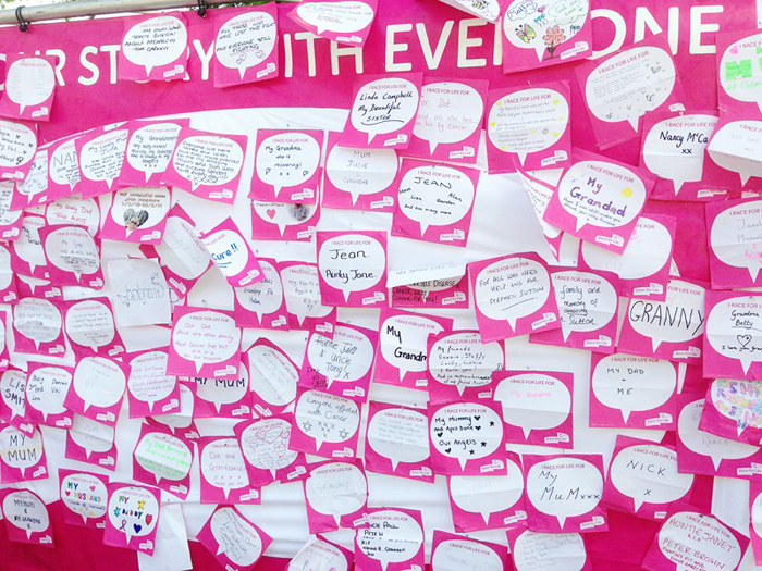 Cancer Research UK's Race For Life fundraiser: wall of back signs | Kate Hadfield Designs
