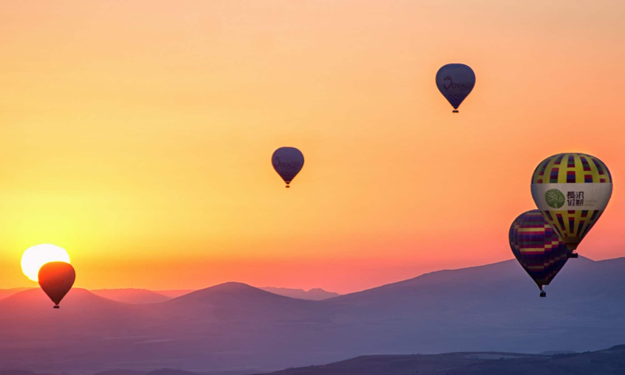 Balloons flying over mountains