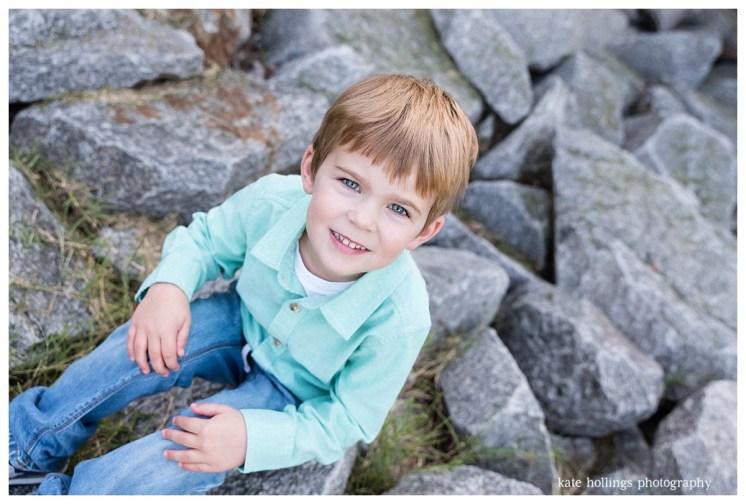 Four year old boy's portrait on riverside