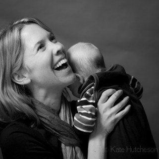 laughing mommy and baby