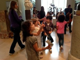 Kids checking out statues at the Louvre