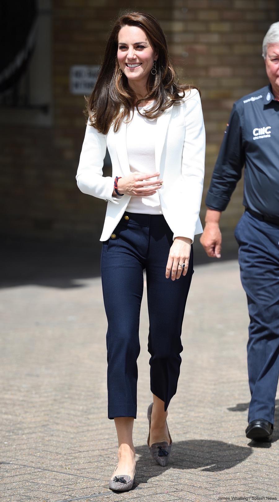 Kate Middleton wearing JCrew pants and a white Zara blazer to the 1851 Trust Roadshow
