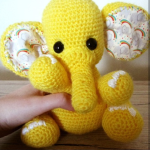 consewvation-elephant-design-yellow-elephants-in ears
