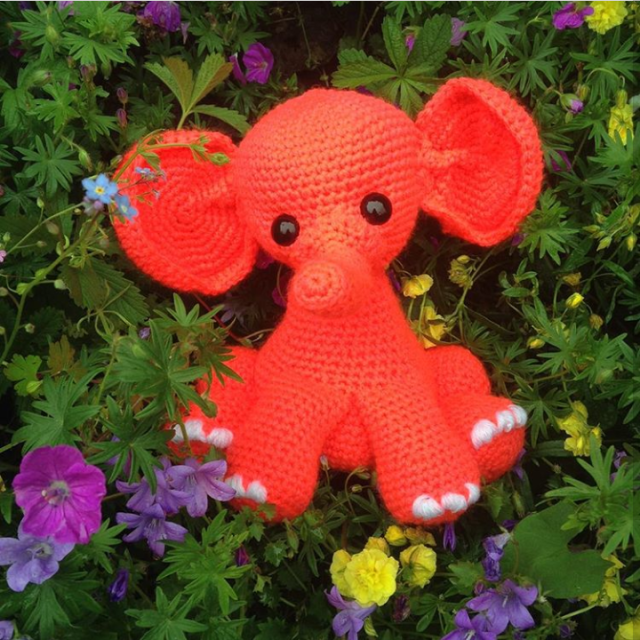 consewvation-elephant-design-red-in-flower-bed
