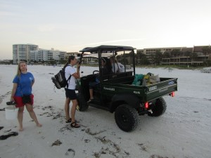 Mote team with patrol vehicle on the beach