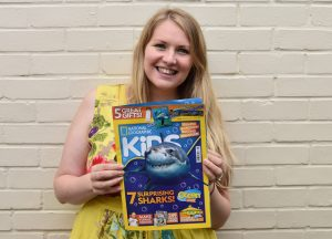 Kate-on-Conservation-holding-Nat-Geo-Kids-Magazine-containing-her-Big-Interview-with-hammerhead-sharks-expert-Ilena-Zanella