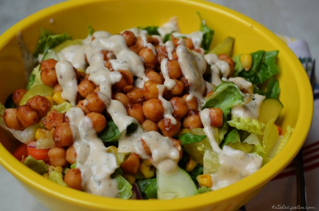 Salad with bbq chickpeas, corn, cucumber, pickles, red onion, carrots, and tahini ranch dressing.
