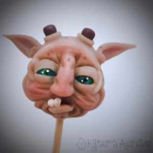 Hand sculpted Polymer Clay Ogre Face by Katie Oskin of KatersAcres
