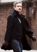 Martin Freeman as Watson. Showing off the 'stache
