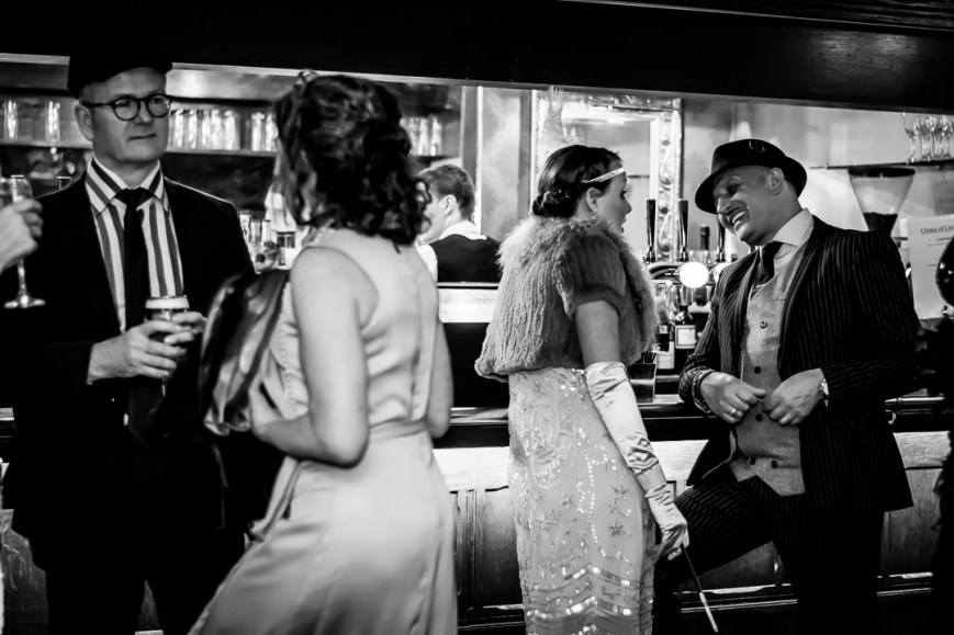 People talking whilst standing at the bar. First photography session as a photographer.