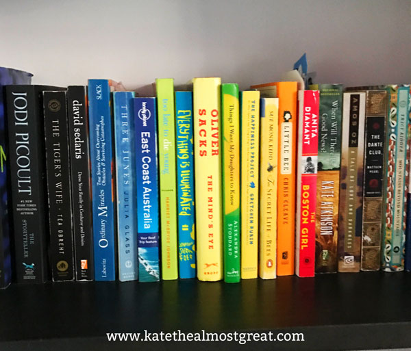 One way to organize your books on your shelf is by color! Check out my blog post to learn more about how I personally organize my large collection of books and how I make sure no one steals mine.