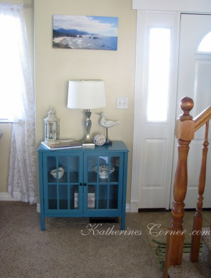 turquoise curio table