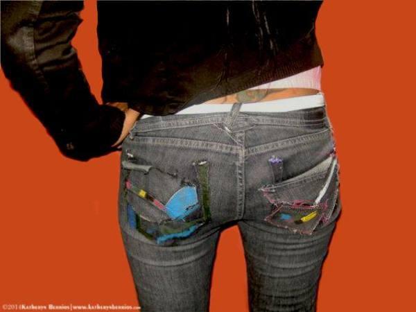 Intervención en pantalón dénim , detalles de rasgado, pintura a mano .
