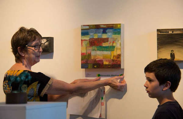 """Mary Rezny giving Honorable Mention to Laura Eklund's """"Concentrated Openness"""" at """"notBIG(3)""""exhibit, photo Melissa Hall"""