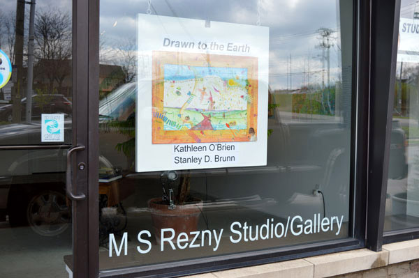 """Front window at MS Rezny Studio/Gallery for """"Drawn to the Earth"""""""