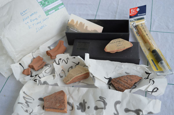 Ostracons and Japanese brush from Nona Orbach, Israel