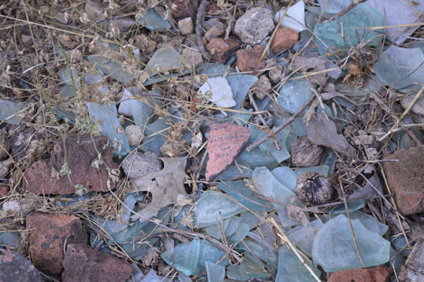 Ostracon with glass shards at the Ice House excavation at Shaker Village of Pleasant Hill