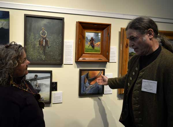 """Mark Selter with his oil paintings (""""Cane"""") at """"225: Artists Celebrate Kentucky's History"""" reception: photo, Greg Orth"""