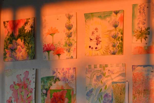 Equinox shadows on art wall, summer watercolors by Kathleen O'Brien