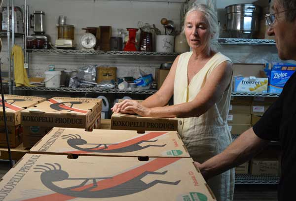Jennifer Gleason with peach boxes