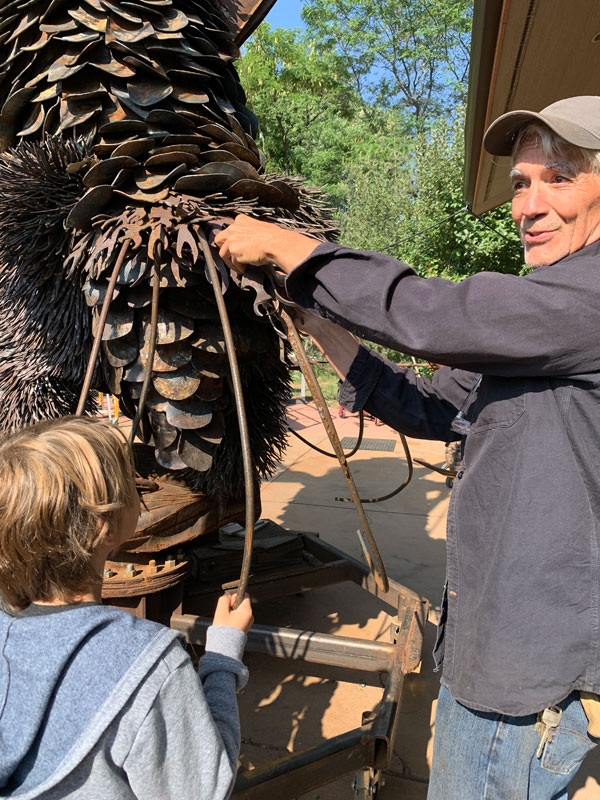 Robert Bellows showing grandson the scales of the Phoenix at Warrior StoryField