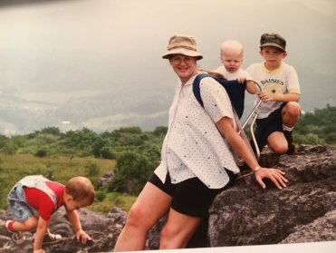 All four of my boys are in this picture. Andrew on my back, David on the rock, Adam bending down, and Peter in my belly. Spring of 1994.
