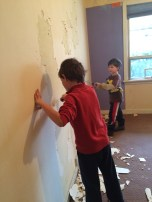 Boys helping with wallpaper removal, screwdriver style.