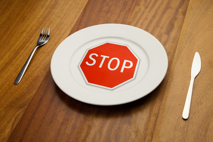 diet concept - stop sign on the plate