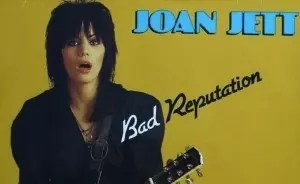 Joan Jett with guitar from Bad Reputation album