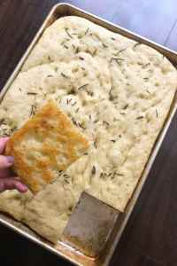 Fluffy Focaccia made easy with this no knead recipe. Simply let the dough rise overnight and you're almost good to go. The overnight wait is totally worth it. Kathleenscravings.com