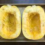 Spaghetti squash halves drizzles with olive oil and seasoned with salt and pepper