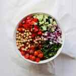 Greek Chickpea Salad is a perfect vegan side dish. No cooking, healthy, clean ingredients and keeps well in the fridge. Add this recipe to your meal prep rotation!