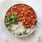 Vegan Chickpea Tikka Masala is perfect for meatless Monday or for healthy vegan meal prep for the week. Using pantry staple ingredients like canned coconut milk to make it creamy but dairy-free.