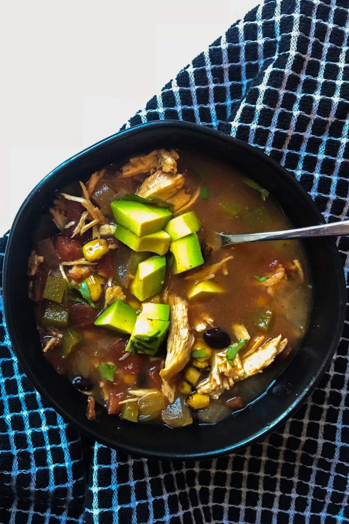 Slow Cooker Chicken Tortilla Soup is a staple recipe that uses pantry staples to bring Mexican-inspired flavors in a warm, comforting, and filling bowl of soup.