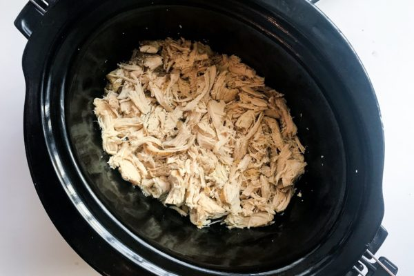 A super easy way to make shredded chicken without heating up your oven or standing over the stove. All you need is chicken breasts, salt and pepper, and a little oil. Set it and forget it. Perfect for meal prep to use in different recipes throughout the week.