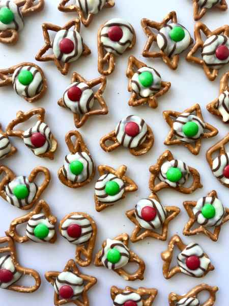 Pretzel Hugs are the perfect combination of salty and sweet. Easily made with just 3 ingredients and perfect to make ahead for some holiday prep. Recipe at KathleensCravings.com #holidaytreats #christmastreats #easyholidaytreats #pretzeltreats