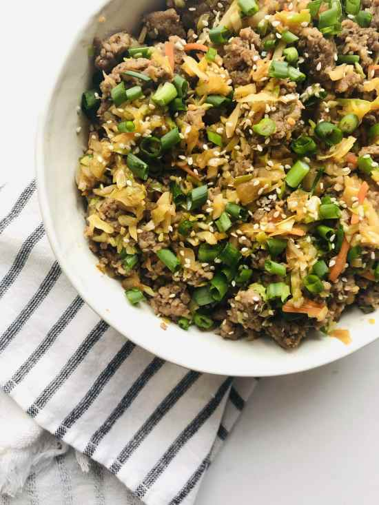 These Pork Egg Roll Bowls check all the boxes. Simple, healthy, low-carb, ready in under 30 minutes, and even can be Whole30 compliant. Can you ask anything more from a takeout, fakeout recipe? Recipe at KathleensCravings.com #Whole30recipes #lowcarb30minutemeal #takeoutfakeout