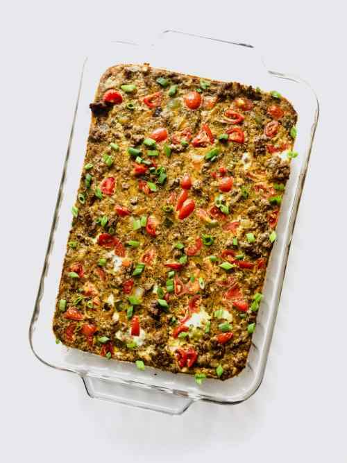 This Taco Egg Bake is colorful, flavorful and perfect for a weekend morning breakfast or to use as meal prep throughout the week. Whole30 compliant and paleo. Recipe at KathleensCravings.com #whole30breakfast #paleomealprep #paleobreakfast #whole30eggbake