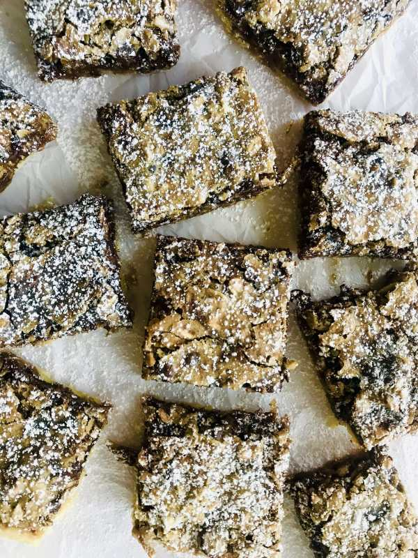 Ooey, gooey brown butter topping loaded with oats, chocolate, and coconut. All atop a buttery shortbread crust. Melt in your mouth good. Recipe at KathleensCravings.com #dessertbars #sweettreat #sweettooth