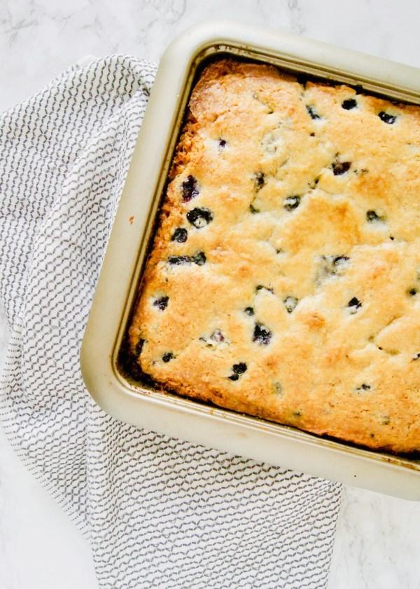 Meet your new breakfast or brunch bff? Lemon Blueberry Breakfast Cake is moist from the buttermilk, uses lemon zest to provide subtle lemon flavor, and chock FULL of fresh blueberries. Recipe at KathleensCravings.com #breakfastcake #coffeecake #buttermilkrecipes #brunchrecipe #blueberries