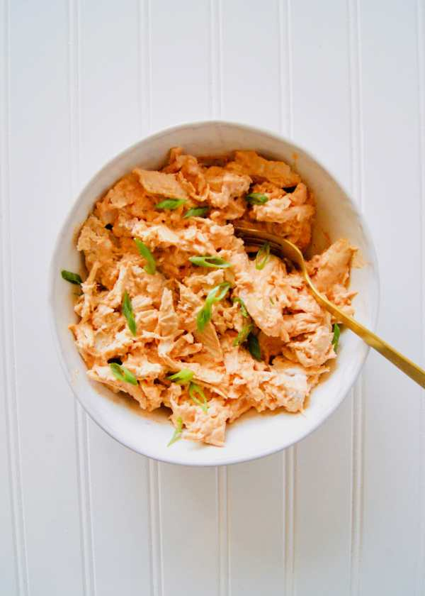 Healthy Buffalo Chicken is just 3 ingredients. Serve the shredded buffalo chicken on a sandwich, wrap, with crackers, or as a healthy buffalo chicken dip. Recipe at KathleensCravings.com #KathleensCravings #buffalochicken #healthybuffalochicken #buffaloshreddedchicken #greekyogurt #greekyogurtbuffalochicken