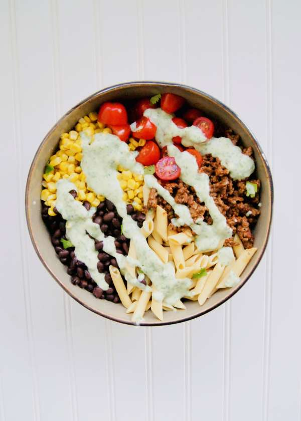 Healthy Taco Pasta Salad is simple to make, minimal prep, and filling for the whole family! This Creamy Pasta Salad has a healthy twist. Tossed with a greek yogurt based avocado cilantro dressing. Recipe at KathleensCravings.com #KathleensCravings #pastasalad #tacosalad #healthypastasalad #healthytaco #creamypastasalad