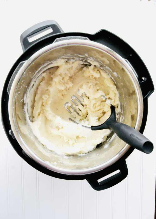 Instant Pot Mashed Potatoes are creamy and so easy to make. Much faster than cooking on the stove. Cook the potatoes and mash them all in your pressure cooker. Recipe at KathleensCravings.com #mashedpotatorecipe #instantpotmashedpotatoes #instantpotsides #instantpotrecipe #instantpotthanksgiving #instantpotpotatoes