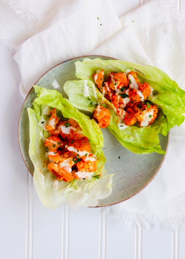 Buffalo Cauliflower Lettuce wraps are so simple and easy to make. Perfect for satisfying your buffalo craving in a healthy, plant-based, meatless way. Perfect as an appetizer or as part of a Meatless Monday dinner. Recipe at KathleensCravings.com #kathleenscravings #meatlessmonday #plantbased #cleaneating #vegetarianappetizer #buffalolettucewraps #cauliflowerrecipes
