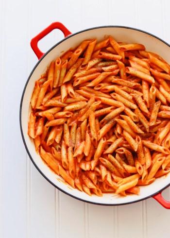 Vegan creamy tomato pasta in skillet
