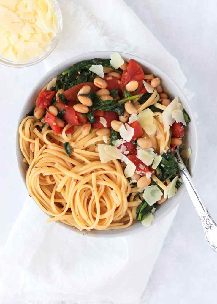 Vegetarian Tuscan White Bean Pasta in bowl with parmesan cheese