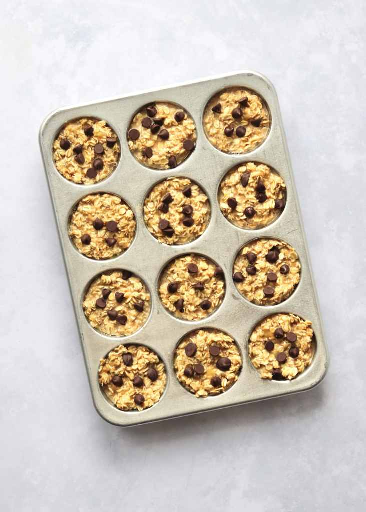 Unbaked banana oatmeal cups in a muffin tin