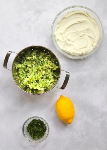 Greek Yogurt, cucumber, lemon, and dill in bowls