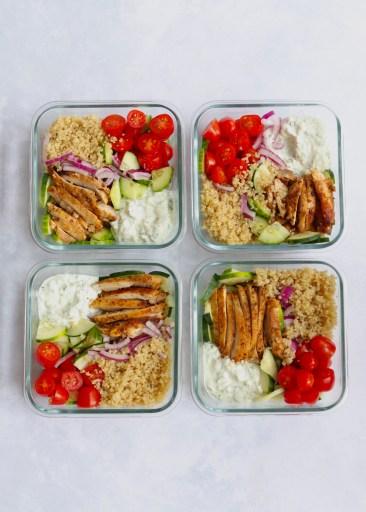 4 assembled greek chicken and quinoa meal prep bowls